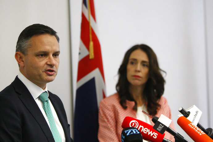 New Zealand Climate Change Minister James Shaw, left, and Prime Minister Jacinda Ardern talk to reporters on Wednesday, May 8, 2019, in Wellington, New Zealand. The government has introduced an ambitious climate change bill which aims to make the nation carbon neutral by 2050 while giving some leeway to farmers.(AP Photo/Nick Perry)