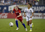 File-This Oct. 3, 2019, file photo shows United State's Rose Lavelle, left, dribbles past South Korea's Cho So-hyun, right, during a soccer match in Charlotte, N.C. Lavelle scored a goal in a World Cup final win over the Netherlands. Could be a big factor for the Americans at the Tokyo Games.   (AP Photo/Mike McCarn, File)