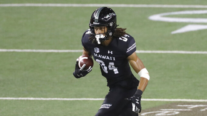 Hawaii wide receiver Nick Mardner runs in for a touchdown against New Mexico during the second quarter of an NCAA college football game Saturday, Nov. 7, 2020, in Honolulu. (AP Photo/Marco Garcia)