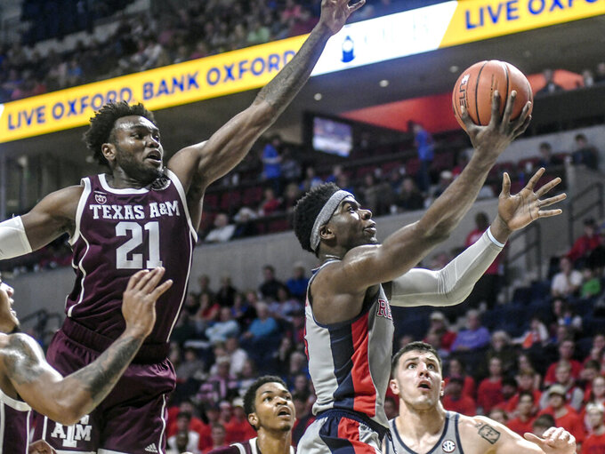 Mississippi guard Terence Davis (3) shoots against Texas A&M's Christian Mekowulu (21) during an NCAA college basketball game, Wednesday, Feb. 6, 2019 in Oxford, Miss. (Bruce Newman/The Oxford Eagle via AP)