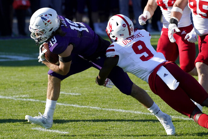 Northwestern wide receiver Riley Lees, left, is tackled by Nebraska defensive back Marquel Dismuke during the second half of an NCAA college football game in Evanston, Ill., Saturday, Nov. 7, 2020. Northwestern won 21-13. (AP Photo/Nam Y. Huh)