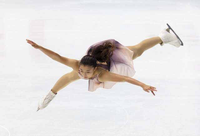 Kaori Sakamoto of Japan performs during a short program of an ISU Grand Prix of Figure Skating competition in Kadoma near Osaka, Japan, Friday, Nov. 27, 2020. (AP Photo/Hiro Komae)
