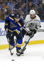 St. Louis Blues' Ivan Barbashev, of Russia, and Los Angeles Kings' Michael Amadio (10) vie for control of the puck during the second period of an NHL hockey game Thursday Oct. 24, 2019, in St. Louis. (AP Photo/Scott Kane)