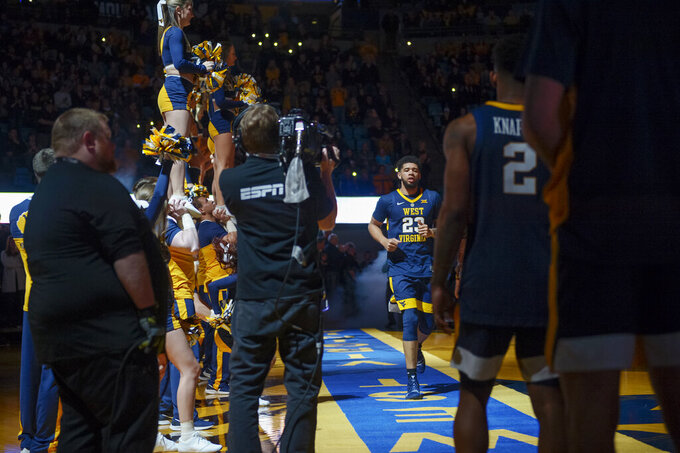 West Virginia dismisses Ahmad, Harris for rule violations