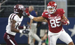 Arkansas tight end Cheyenne O'Grady (85) carries the ball as Texas A&M defensive back Keldrick Carper (14) pursues during the first half of an NCAA college football game Saturday, Sept. 28, 2019, in Arlington, Texas. (AP Photo/Ron Jenkins)