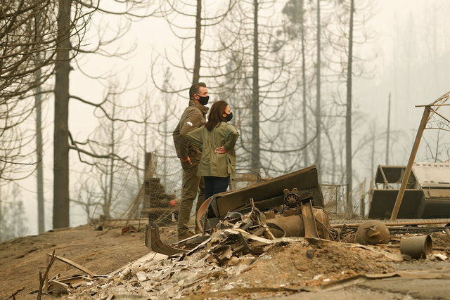 California Gov. Gavin Newsom and Democratic vice presidential candidate Sen. Kamala Harris, D-Calif., talk as they asses the damage during the Creek Fire at Pine Ridge Elementary, Tuesday, Sept. 15, 2020, in Auberry, Calif. (AP Photo/Gary Kazanjian)