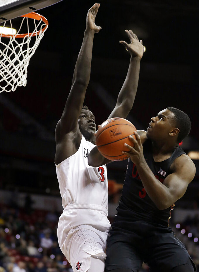 San Diego State's Aguek Arop (3) defends as UNLV's Amauri Hardy shoots during the second half of an NCAA college basketball game in the Mountain West Conference men's tournament Thursday, March 14, 2019, in Las Vegas. (AP Photo/Isaac Brekken)