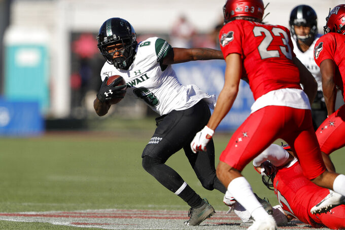 Hawaii wide receiver Cedric Byrd II (6) carries the ball after a reception during the first half of an NCAA college football game against UNLV in Las Vegas, Saturday, Nov. 16, 2019. (Steve Marcus/Las Vegas Sun via AP)