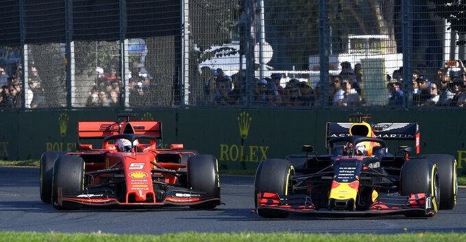 Red Bull driver Max Verstappen of the Netherlands, right, passes Ferrari driver Sebastian Vettel of Germany during the Australian Formula 1 Grand Prix in Melbourne, Australia, Sunday, March 17, 2019. (AP Photo/Andy Brownbill)