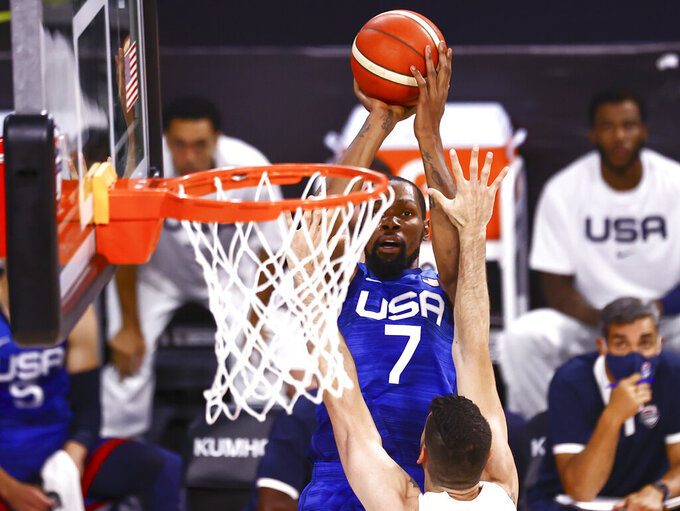 United States' Kevin Durant (7) shoots over Argentina's Patricio Garino during the first half of an exhibition basketball game in Las Vegas on Tuesday, July 13, 2021. (Chase Stevens/Las Vegas Review-Journal via AP)