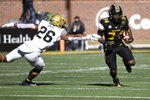 Missouri running back Larry Rountree III (34) runs past Vanderbilt linebacker Anfernee Orji (26) during the first half of an NCAA college football game Saturday, Nov. 28, 2020, in Columbia, Mo. (AP Photo/L.G. Patterson)