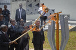 From left to right, Chairperson of the African Union Commission Moussa Faki Mahamat, Rwanda's President Paul Kagame, Rwanda's First Lady Jeannette Kagame, and President of the European Commission Jean-Claude Juncker, light the flame of remembrance at the Kigali Genocide Memorial in Kigali, Rwanda, Sunday, April 7, 2019.  Rwanda is commemorating the 25th anniversary of when the country descended into an orgy of violence in which some 800,000 Tutsis and moderate Hutus were massacred by the majority Hutu population over a 100-day period in what was the worst genocide in recent history. (AP Photo/Ben Curtis)