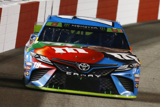Kyle Busch heads into Turn 1 during the NASCAR Cup Series auto race at Richmond Raceway in Richmond, Va., Saturday, Sept. 21, 2019. (AP Photo/Steve Helber)