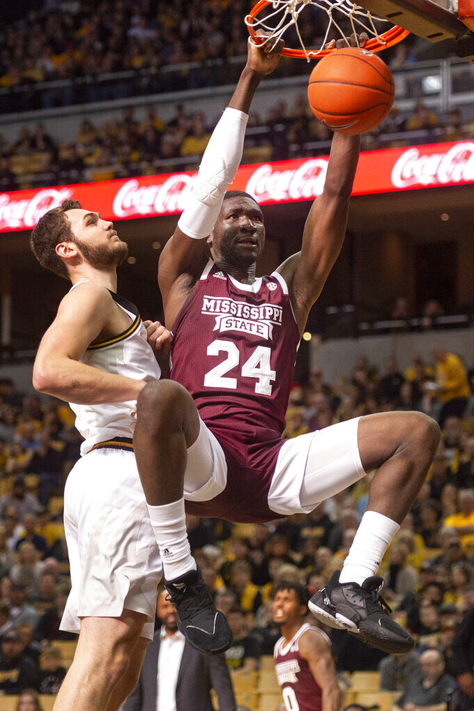 Mississippi State's Abdul Ado, right, dunks the ball past Missouri's Reed Nikko, left, during the first half of an NCAA college basketball game Saturday, Feb. 29, 2020, in Columbia, Mo. (AP Photo/L.G. Patterson)