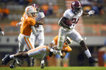 Alabama running back Trey Sanders (24) is tackled by Tennessee defensive back Tamarion McDonald (21) during the fourth quarter of an NCAA college football game in Knoxville, Tenn., Saturday, Oct. 24, 2020. (Caitie McMekin/Knoxville News Sentinel via AP)