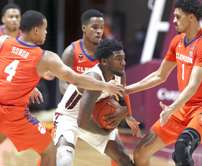 Virginia Tech's Tyrece Radford (23) is surrounded by Clemson defenders in the second half of an NCAA  college basketball game in Blacksburg Va., Tuesday, Dec. 15, 2020.  (Matt Gentry/The Roanoke Times via AP, Pool)