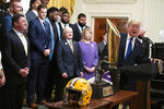 President Donald Trump speaks during an event to honor the NCAA football national champion Louisiana State University Tigers, in the East Room of the White House, Friday, Jan. 17, 2020, in Washington. (AP Photo/ Evan Vucci)