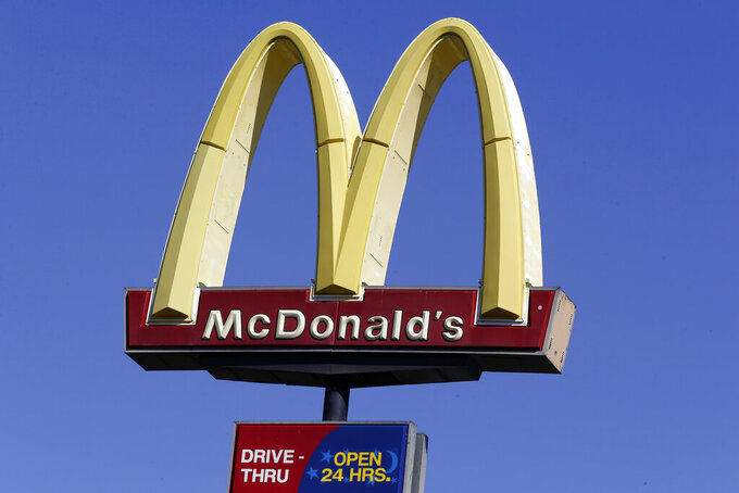 FILE - This Oct. 17, 2019 file photo shows a McDonald's sign along Interstate 40/85 in Burlington, N.C. McDonald's sales improved throughout the second quarter, Tuesday, July 28, 2020,  as markets reopened globally, but the fast food giant still faces a bumpy recovery. (AP Photo/Gerry Broome, File)