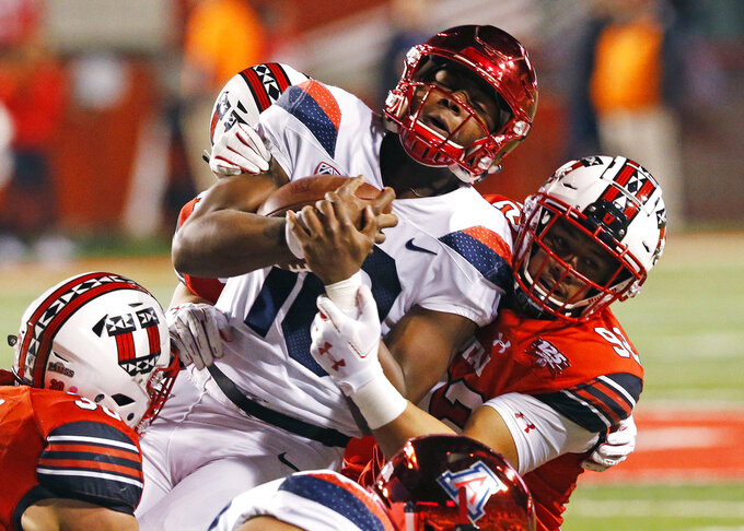 Utah defensive end Maxs Tupai, right, tackles Arizona quarterback Jamarye Joiner (10) during the first half of an NCAA college football game Friday, Oct. 12, 2018, in Salt Lake City. (AP Photo/Rick Bowmer)