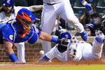 Chicago Cubs' Willson Contreras, right, is safe at home plate as New York Mets catcher James McCann, left, makes a late tag during the third inning of a baseball game, Thursday, April, 22, 2021, in Chicago. (AP Photo/David Banks)
