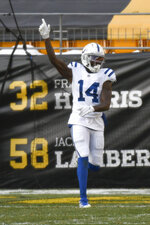 Indianapolis Colts wide receiver Zach Pascal (14) celebrates after making a touchdown catch against the Pittsburgh Steelers during the first half of an NFL football game, Sunday, Dec. 27, 2020, in Pittsburgh. (AP Photo/Don Wright)