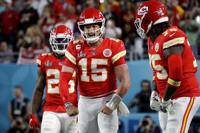 Kansas City Chiefs quarterback Patrick Mahomes (15) celebrates his touchdown the San Francisco 49ers during the first half of the NFL Super Bowl 54 football game Sunday, Feb. 2, 2020, in Miami Gardens, Fla. (AP Photo/Patrick Semansky)
