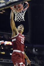 Stanford center Keenan Fitzmorris dunks the ball during the second half of an NCAA college basketball game against Oklahoma Monday, Nov. 25, 2019, in Kansas City, Mo. Stanford won 73-54. (AP Photo/Charlie Riedel)