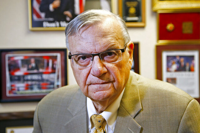 FILE - In this Aug. 26, 2019, file photo, former Maricopa County Sheriff Joe Arpaio poses for a portrait at his private office in Fountain Hills, Arizona. The taxpayer bill for a racial profiling case focusing on Arpaio's immigration patrols is expected to reach $178 million by the summer of 2021. The money is going toward legal fees and the costs of complying with a court-ordered overhaul of the sheriff's office in response to the 2013 profiling verdict. (AP Photo/Ross D. Franklin, File)