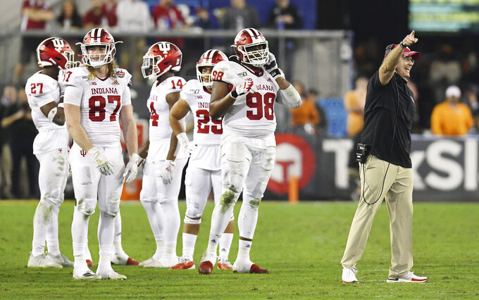 Indiana coach Tom Allen argues with officials about the onside kick by Tennessee late in the fourth quarter of the Gator Bowl NCAA college football game Thursday, Jan. 2, 2020, in Jacksonville, Fla. Tennessee recovered the kick. (Bob Self/The Florida Times-Union via AP)