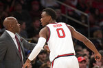 St. John's head coach Mike Anderson talks with Mustapha Heron (0) in the second half of  an NCAA college basketball game against West Virginia, Saturday, Dec. 7, 2019 in New York. St. John's won 70-68. (AP Photo/Mark Lennihan)