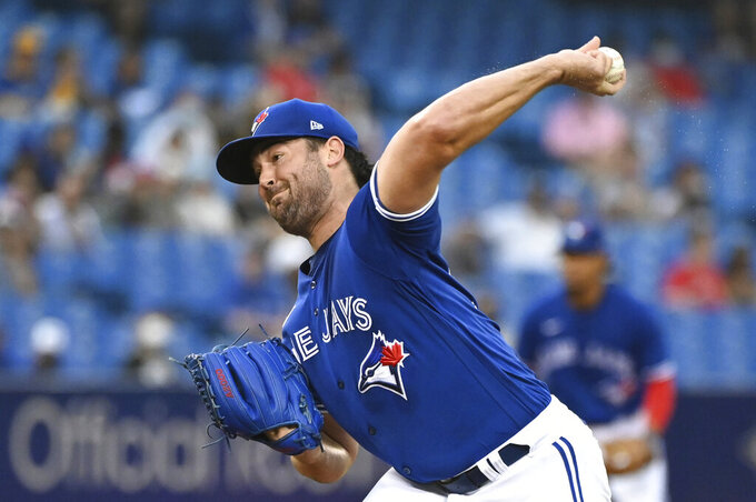 Toronto Blue Jays starting pitcher Robbie Ray throws to a Chicago White Sox batter during the first inning of a baseball game Wednesday, Aug. 25, 2021, in Toronto. (Jon Blacker/The Canadian Press via AP)