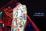 In this Thursday, March 14, 2019, photo, men's suit designed with flowers and birds is displayed for the