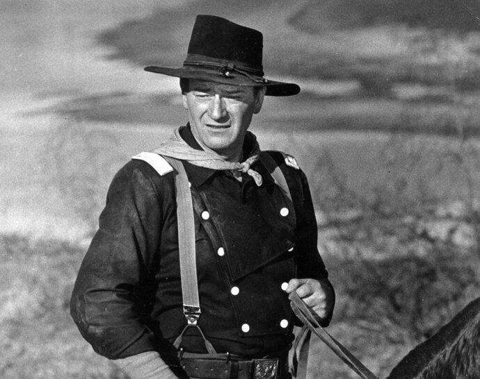 FILE - In this undated photo, John Wayne appears during the filming of