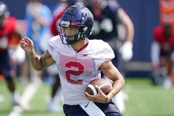 Mississippi quarterback Matt Corral (2) runs with the ball during a morning NCAA college football practice on the Oxford, Miss., campus, Monday, Aug. 9, 2021. (AP Photo/Rogelio V. Solis)