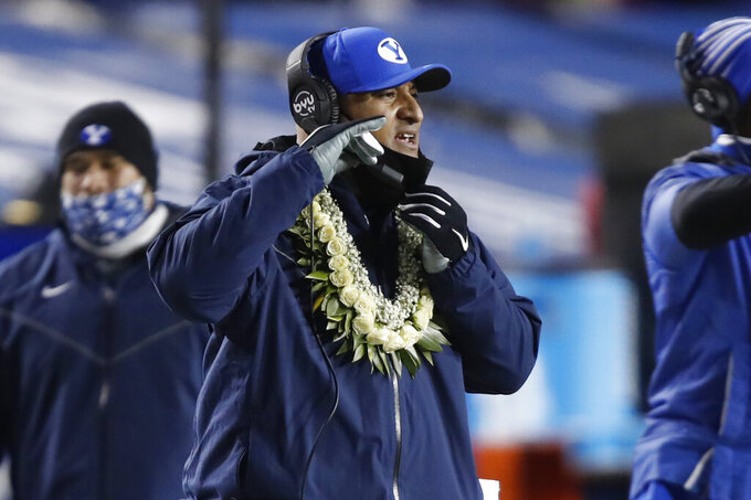 BYU coach Kalani Sitake watches the team during the first half of an NCAA college football game against San Diego State on Saturday, Dec. 12, 2020, in Provo, Utah. (AP Photo/George Frey, Pool)