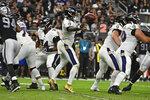 Baltimore Ravens quarterback Lamar Jackson (8) throws a pass against the Las Vegas Raiders during the first half of an NFL football game, Monday, Sept. 13, 2021, in Las Vegas. (AP Photo/David Becker)