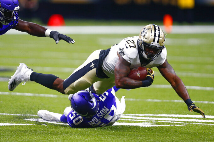 Minnesota Vikings linebacker Eric Wilson (50) tackles New Orleans Saints running back Dwayne Washington (27) in the first half of an NFL preseason football game in New Orleans, Friday, Aug. 9, 2019. (AP Photo/Butch Dill)