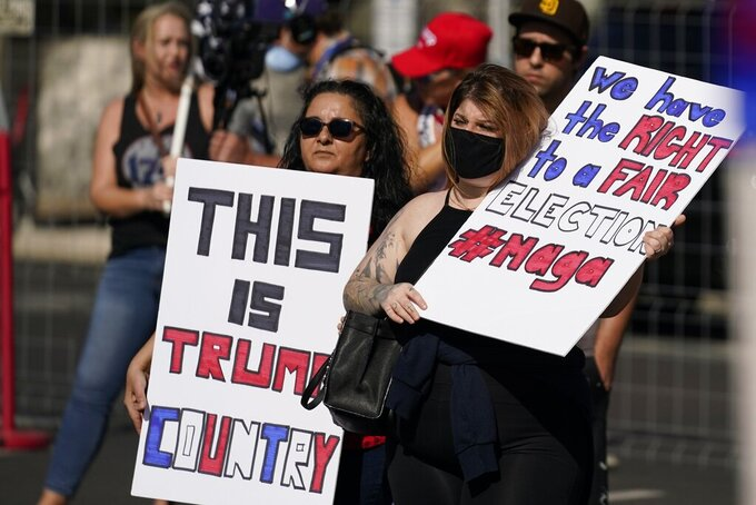 FILE - In this Saturday, Nov. 7, 2020 file photo, Supporters of President Donald Trump rally outside the Maricopa County Recorder's Office in Phoenix. Election officials and experts are raising alarms about the private fundraising surrounding efforts to expand Republican ballot reviews to more states former President Donald Trump falsely claims he won. While some fundraising details have come to light, information about who is donating the money and how it's being spent is largely exempt from public disclosure.  (AP Photo/Ross D. Franklin, File)