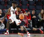 South Carolina guard Wesley Myers (15) drives past Georgia forward Rayshaun Hammonds (20) in the first half of an NCAA college basketball game in Athens, Ga., Saturday, Jan. 13, 2018. (Joshua L. Jones/Athens Banner-Herald via AP)