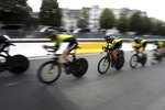 Mitchelton Scott team strains during the second stage of the Tour de France cycling race, a team time trial over 27.6 kilometers (17 miles) with start and finish in Brussels, Belgium, Sunday, July 7, 2019. (AP Photo/Thibault Camus)