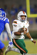 Miami quarterback D'Eriq King (1) carries the football against Duke during the second half of an NCAA college football game Saturday, Dec. 5, 2020, in Durham, N.C. (Nell Redmond/Pool Photo via AP)