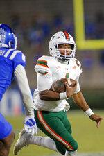 Miami quarterback D'Eriq King (1) carries the football against Duke during the second half of an NCAA college football game Saturday, Dec. 5, 2020, in Durham, N.C. (Nell Redmond/Pool Photo via AP)