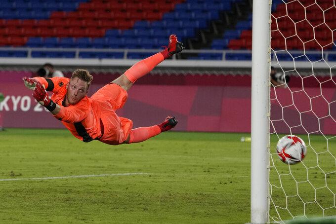 Germany's goalkeeper Florian Mueller fails to stop Brazil's Richarlison scoring his side's third goal during a men's soccer match at the 2020 Summer Olympics, Thursday, July 22, 2021, in Yokohama, Japan. (AP Photo/Kiichiro Sato)