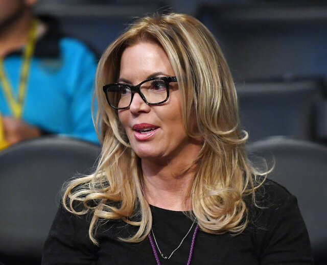 FILE - In this March 3, 2017, file photo, Los Angeles Lakers president Jeanie Buss sits in the stands prior to an NBA basketball game between the Lakers and the Boston Celtics in Los Angeles. The Lakers have repaid a loan of roughly $4.6 million from coronavirus business relief funds after learning the program had been depleted. (AP Photo/Mark J. Terrill, File)