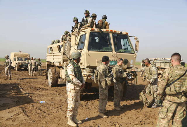 FILE - In this Sunday, Jan. 24, 2016 file photo, Iraqi soldiers participate in a training exercise with American and Spanish trainers, which includes live ammunition, at Basmaya base, 40 kilometers southeast of Baghdad, Iraq. The U.S. and Iraq launched much-anticipated strategic talks on Thursday, June 11, 2020, spanning the gamut of bilateral relations with Washington prioritizing the future of its forces in the country, and Baghdad, a dire economic crisis. But the outcome of discussions will be months away, U.S. and Iraqi officials said. (AP Photo/Karim Kadim, File)