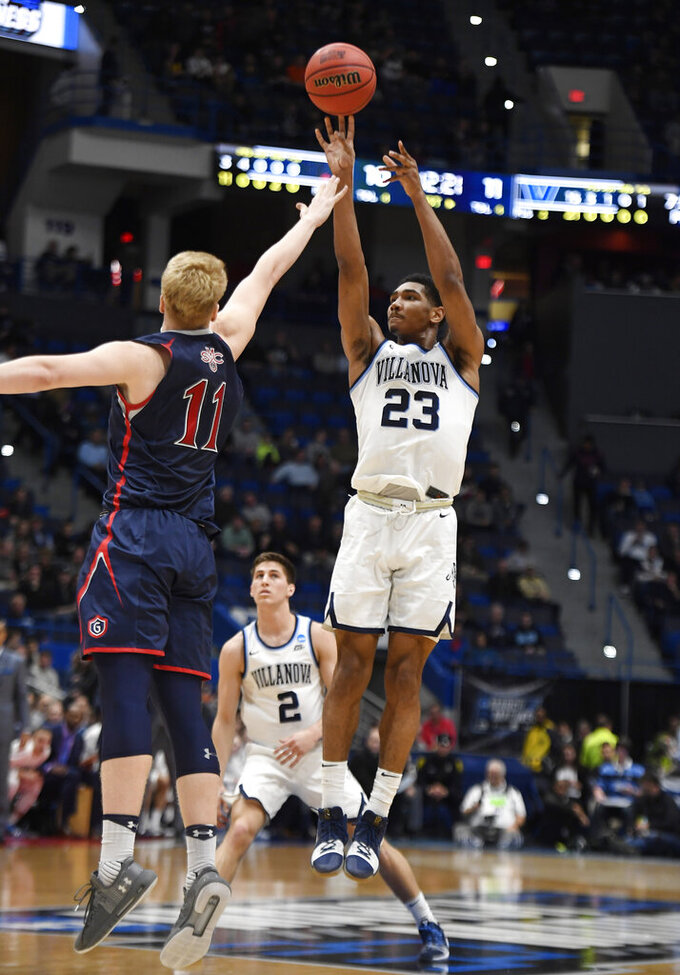 Villanova's Jermaine Samuels (23) shoots over St. Mary's Matthias Tass (11) during the first half of a first round men's college basketball game in the NCAA tournament, Thursday, March 21, 2019, in Hartford, Conn. (AP Photo/Jessica Hill)