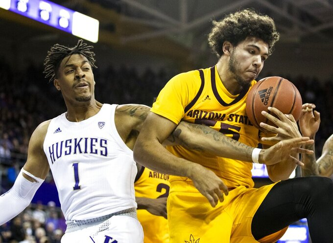 Washington forward Nate Roberts (1) reaches for the ball against Arizona State forward Taeshon Cherry (35) on a rebound during an NCAA college basketball game Saturday, Feb. 1, 2020, in Seattle. (Amanda Snyder/The Seattle Times via AP)