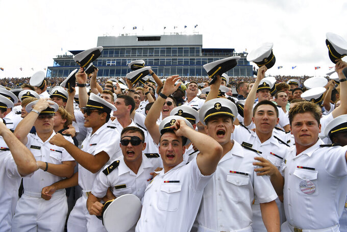The Brigade of Midshipmen cheer before an NCAA college football game between Navy and Air Force, Saturday, Sept. 11, 2021, in Annapolis, Md. (AP Photo/Terrance Williams)