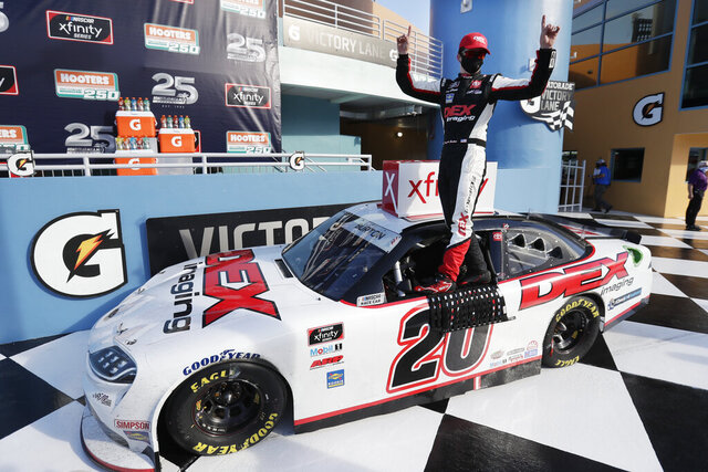 Harrison Burton celebrates after winning a NASCAR Xfinity Series auto race Saturday, June 13, 2020, in Homestead, Fla. (AP Photo/Wilfredo Lee)