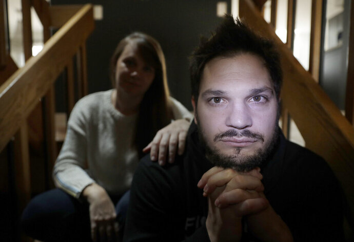 In this Tuesday, April 2, 2019, photo, former NHL player Dan Carcillo poses for a portrait with his wife Ela at his rural home in Homer Glen, Ill. Carcillo is hurting inside and out after seven documented concussions in the National Hockey League and what he believes could be hundreds of traumatic brain injuries. Almost a year removed from his last round of neurological treatment in early April, the bad days outnumber the good and the suicidal thoughts returned. Carcillo explains where his head is at. This is a bad day.